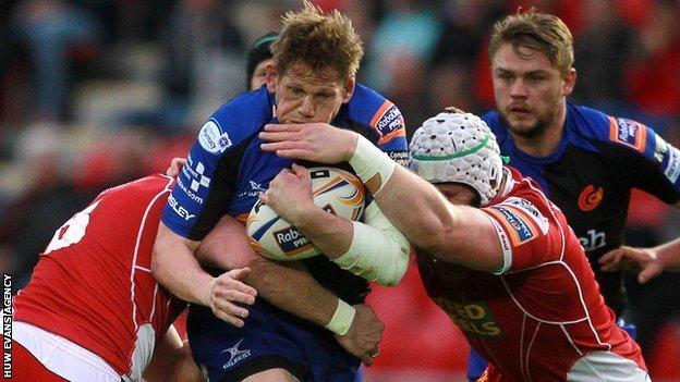 Jake Ball tackles Rhys Thomas