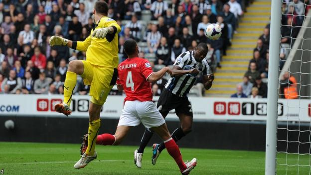 Shola Ameobi scores Newcastle's first goal in their Premier League clash against Cardiff City at St James' Park