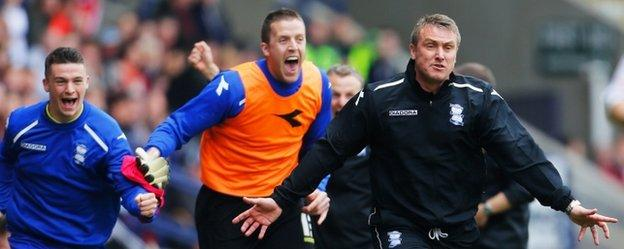 Birmingham City manager Lee Clark and his bench celebrate clinching Championship survival