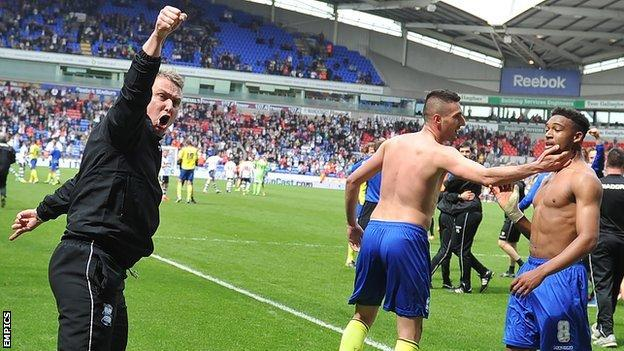 Birmingham manager Lee Clark celebrates at ensuring Championship survival for his side with a 2-2 draw at Bolton
