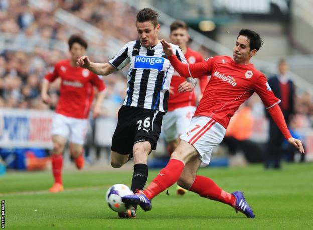 Cardiff's Peter Whittingham tackles Mathieu Debuchy