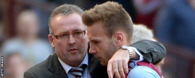 Aston Villa manager Paul Lambert with forward Andreas Weimann