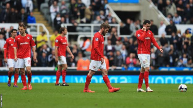 Cardiff's players are dejected as their 3-0 defeat leaves them relegated to the Championship for next season