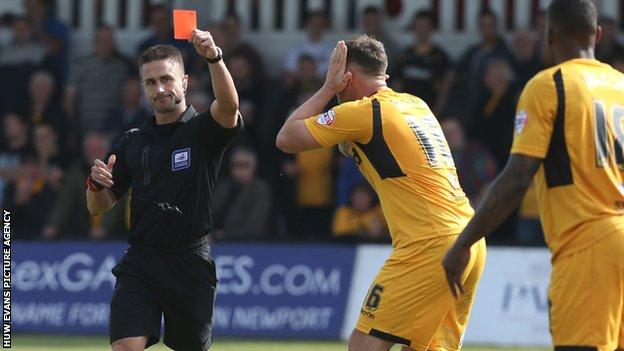 Ryan Jackson (far right) is shown the red card dyring Newport's 2-1 win over Rochdale