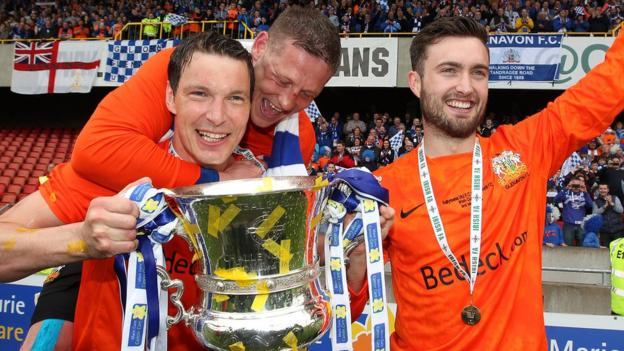 Glenavon's cup final goal scorers Kyle Neill and Mark Patton celebrate with skipper Kris Lindsay after the 2-1 victory over Ballymena United