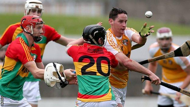 Three Carlow players close in on Antrim's Aaron Graffin