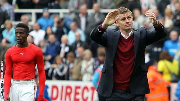Ole Gunnar Solskjaer applauds Cardiff's fans after the 3-0 defeat at Newcastle