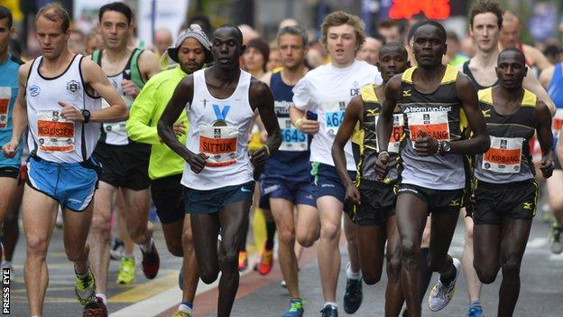 Freddy Sittuk and the only main contenders in the opening moments of the Belfast City Marathon
