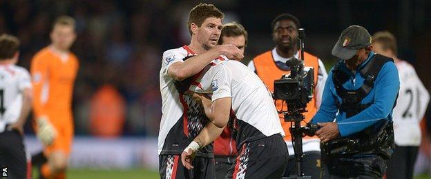 Gerrard puts a consoling arm around a tearful Suarez