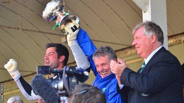 Guernsey coach Steve Sharman lifts the 2013 Muratti