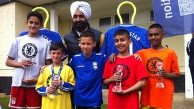 Chelsea Asian Star winners from left - Qasim Khan, Ibrahim Khan, Rayhaan Majid and Kamran Khalid with their trophies and previous winner Sam Khan (front centre)