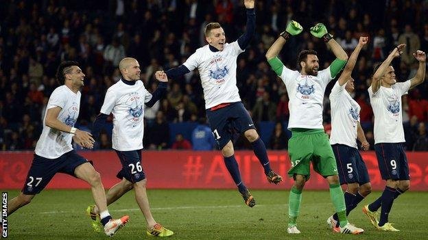 Paris St-Germain players take the acclaim of their supporters after winning their second straight Ligue 1 title