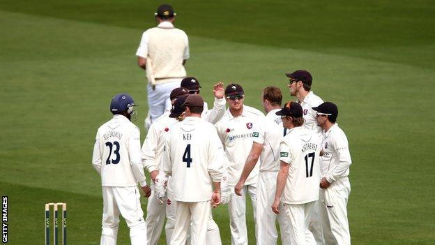 Kent players celebrate the departure of Surrey batsman Graeme Smith