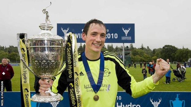 Gary Innes with the Camanachd Cup in 2010