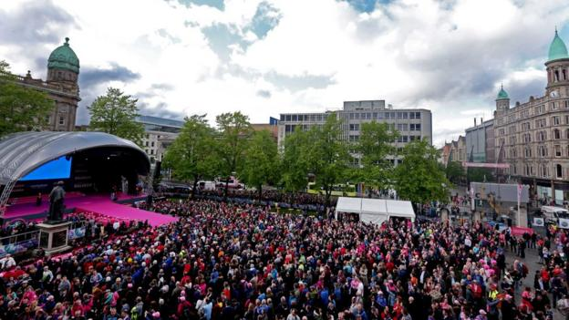 Thousands of spectators were in Donegall Square in Belfast City centre to get a first look of the riders before the 97th Giro d'Italia