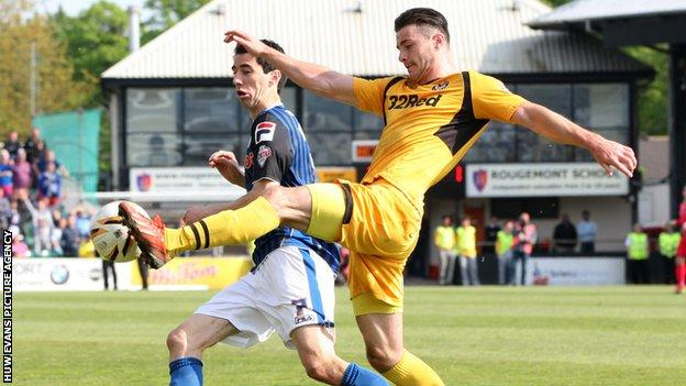 Newport's Andrew Hughes challenges Rochdale's Peter Vincenti