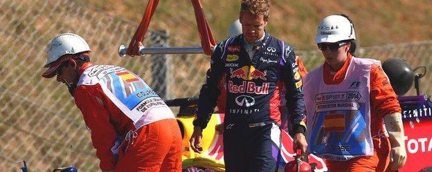 Sebastian Vettel walks away from his Red Bull
