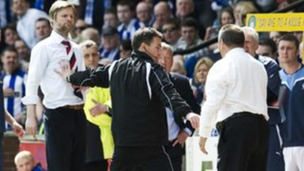 Kilmarnock manager Jimmy Calderwood and Falkirk's Stephen Pressley clash on the touchline