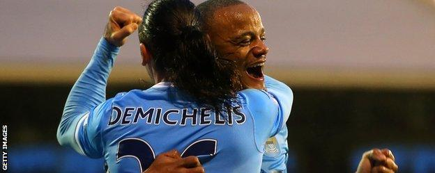 Manchester City defenders Martin Demichelis and Vincent Kompany