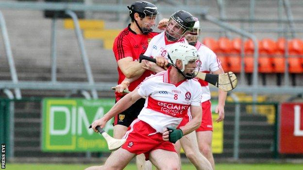 Oisin McCloskey (centre) scored Derry's goal against Down