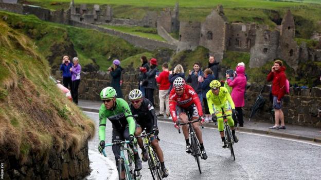 Breakaway riders Jeffry Johan Romero Corredor, Maarten Tjallingii, Sander Armee and Andrea Fedigo past Dunluce Castle during stage two of the Giro d'Italia in Northern Ireland
