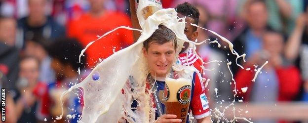 Bayern Munich's Jerome Boateng pours beer over team-mate Toni Kroos