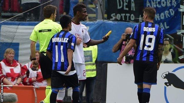 AC Milan defender Kevin Constant picks up banana