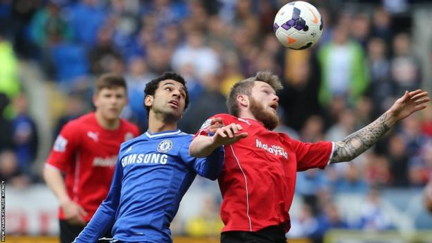 Chelsea winger Mohamed Salah battles for the ball with Cardiff City midfielder Aron Gunnarsson on the final day of the Premier League season at Cardiff City Stadium.