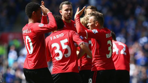 Craig Bellamy celebrates with his Cardiff City team-mates after giving his side the lead against Chelsea.