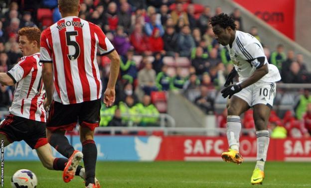 Swansea City top-scorer Wilfried Bony scores his side's third goal at the Stadium of Light.