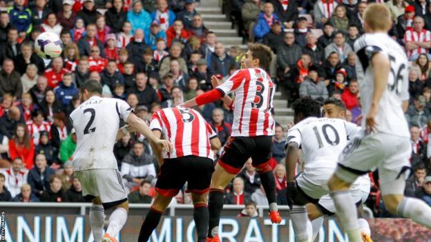 Former Swansea City striker Fabio Borini, on loan from Liverpool, heads home for Sunderland