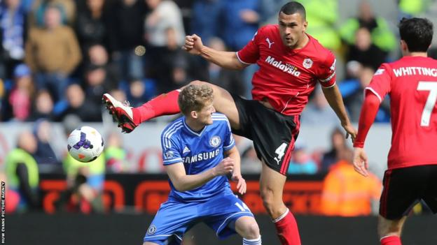 Steven Caulker gets above Chelsea goalscorer Andre Schurrle during already relegated Cardiff City's 2-1 home defeat on the final day of the Premier League season.