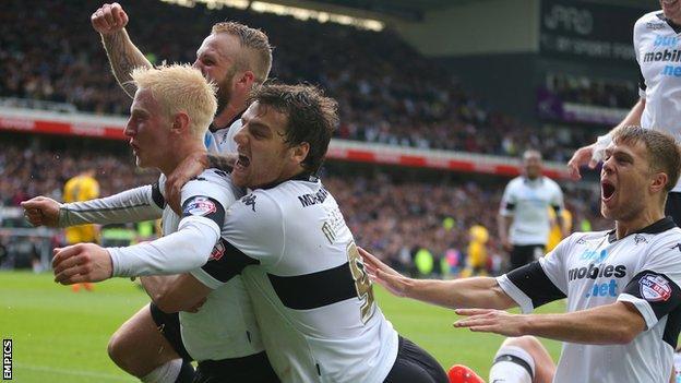 Will Hughes celebrates