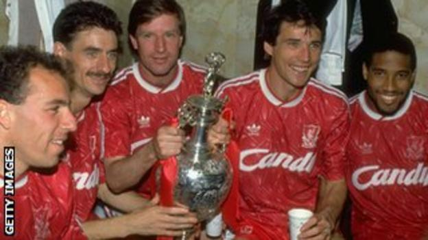 Alan Hansen, Ian Rush and Ronnie Whelan share the First Division trophy