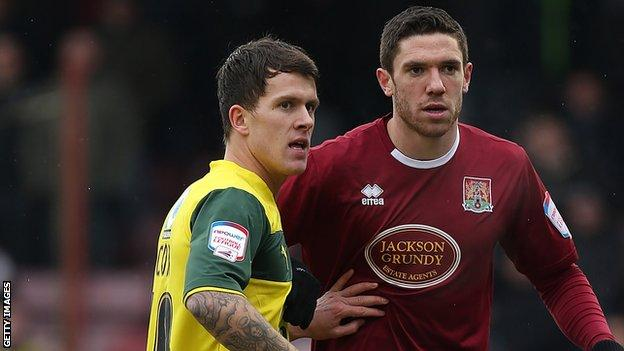 Lee Cox (left) playing for Plymouth at Northampton