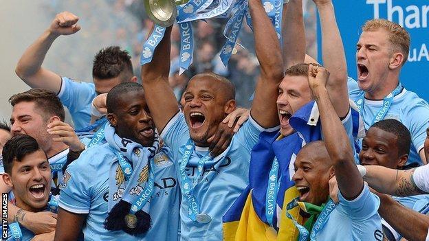 Manchester City players celebrate winning Premier league title