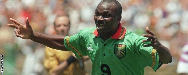 Roger Milla celebrates scoring for Cameroon in 1994