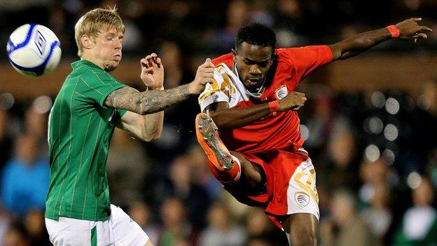 Andy Keogh battles with Saad Al Mukhaini in the September 2012 friendly between the countries at Craven Cottage