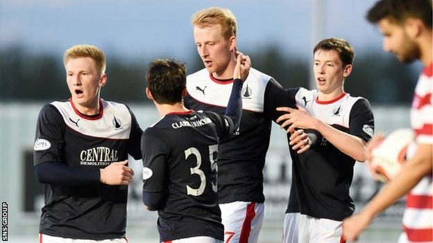 Mark Beck (centre) scored the equaliser for Falkirk
