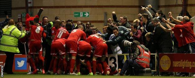 Dean Cox is mobbed after scoring against Peterborough