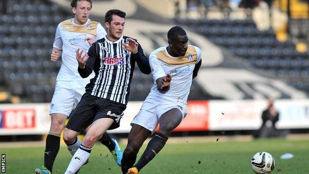 Jimmy Spencer (centre) in action for Notts County against Colchester