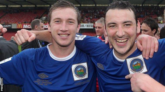 Mark McAllister and Michael Gault celebrate winning the Irish Cup with Linfield in 2011