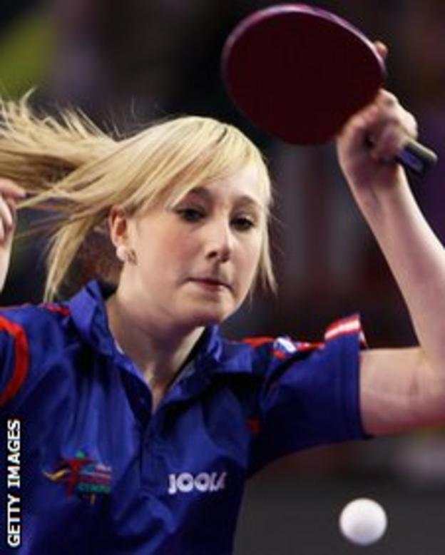 Charlotte Carey playing table tennis.