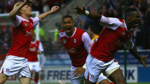 Rotherham players celebrate Kieran Agard's goal