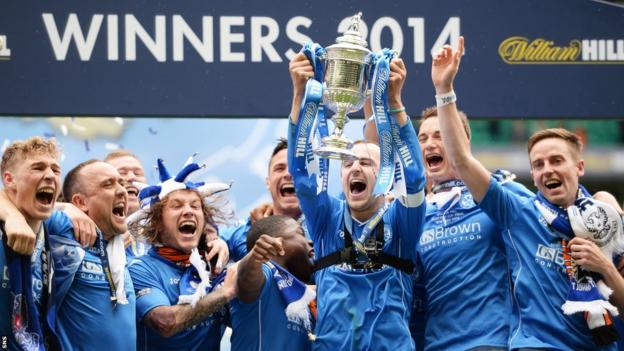 St Johnstone players celebrate with the Scottish Cup trophy