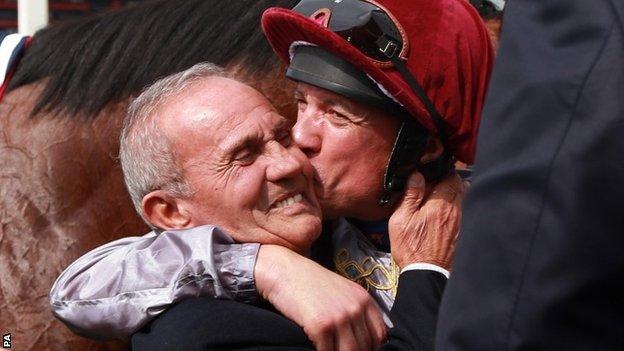 Frankie Dettori plants a kiss on his father Gianfranco's cheek at Newbury