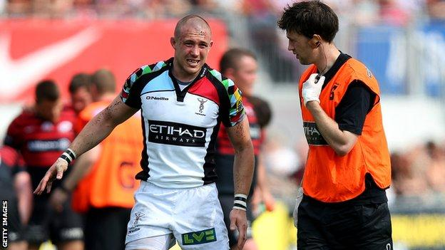 Harlequins winger Mick Brown hobbles off in the Premiership semi-final defeat by Saracens