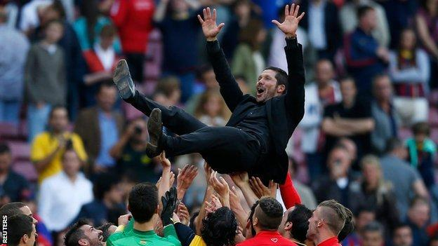 Atletico Madrid's title-winning players celebrate by throwing coach Diego Simeone into the air