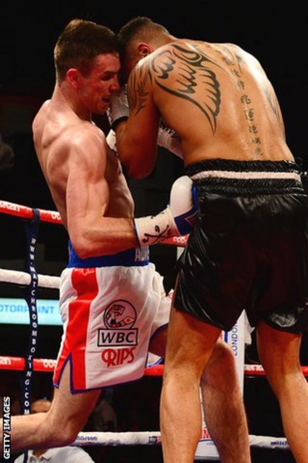 Callum Smith (L) lands a body shot on Tobias Webb in their WBC International super-middleweight fight