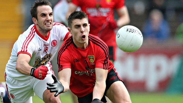 Tyrone's Mark Donnelly moves in on Down opponent Ryan Boyle